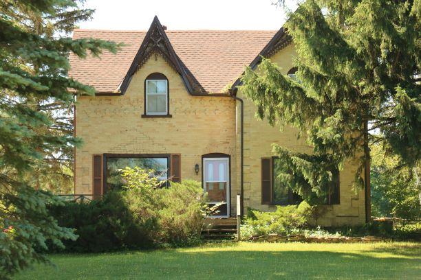 Charming Yellow Brick Farm House